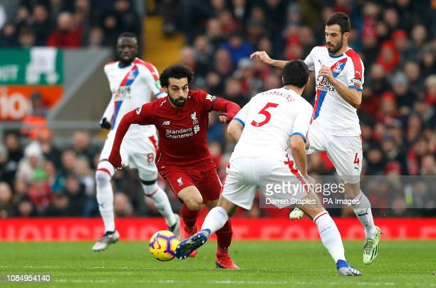 Liverpool's Mohamed Salah under pressure from Crystal Palace's James Tomkins and Luka Milivojevic during the Premier League match at Anfield Liverpool