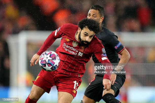 Liverpool's Mohamed Salah vies for possession with Atletico Madrid's Renan Lodi during the UEFA Champions League round of 16 second leg match between...