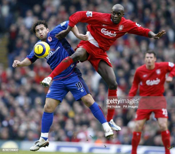 Liverpool's Momo Sissoko challenges Middlesbrough Fabio Rochemback for the ball during the Barclays Premiership match at Anfield Liverpool Saturday...