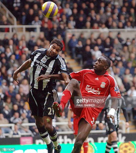 Liverpool's Momo Sissoko challenges Newcastle's Habib Beye during today's Premiership clash at St James Park in Newcastle 24 November 2007 AFP PHOTO...