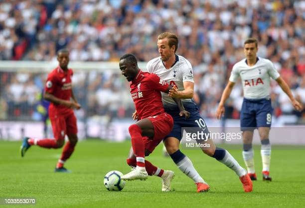 Liverpool's Naby Keita holds off the challenge from Tottenham Hotspur's Harry Kane during the Premier League match between Tottenham Hotspur and...