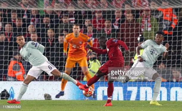 Liverpool's Naby Keita shoots despite the attentions of Bayern Munich's Thiago Alcantara and David Alaba during the UEFA Champions League Round of 16...