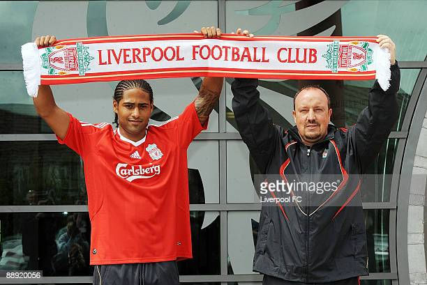 Liverpool's new signing Glen Johnson and Liverpool manager Rafael Benitez hold up a Liverpool scarf at Melwood training ground to confirm the signing...