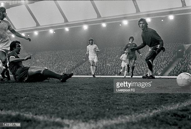 Liverpool's new signing Ray Kennedy slides on the ground as West Ham United goalkeeper Mervyn Day watches the shot go wide during the English First...