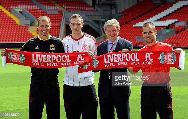 Liverpools new signings Milan Jovanovic , Danny Wilson , and Joe Cole pose for photographs with manager Roy Hodgson at Anfield on July 27, 2010 in...