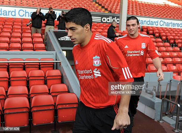 Liverpool's new signings Uruguayan striker Luis Suarez and English striker Andy Carroll arrive for a photocall at Anfield Liverpool northwest England...