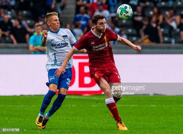 Liverpool's newly acquired Scottish defender Andy Robertson vies with Hertha's defender Julius Kade during the friendly football match Hertha Berlin...