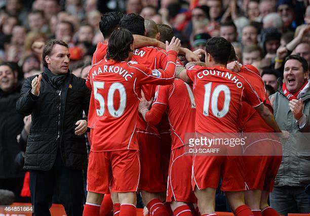 Liverpool's Northern Irish manager Brendan Rodgers and Liverpool players celebrate their first goal during the English Premier League football match...