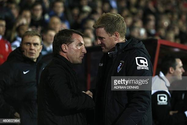 Liverpool's Northern Irish manager Brendan Rodgers is greeted by Bournemouth's English manager Eddie Howe before the start of the English League Cup...