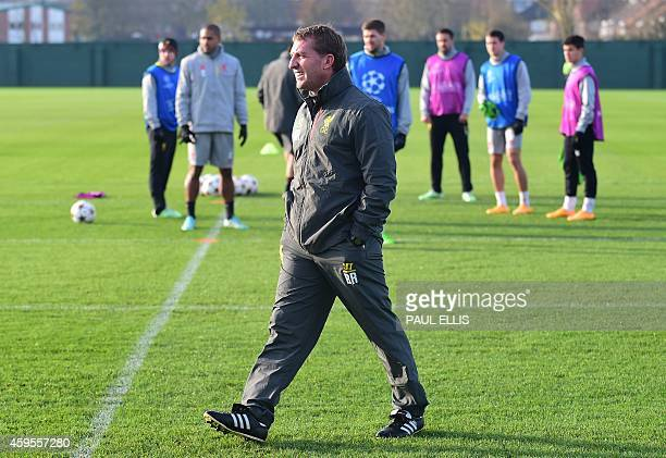 Liverpool's Northern Irish manager Brendan Rodgers supervsises a training session at their Melwood training ground in Liverpool, north west England,...