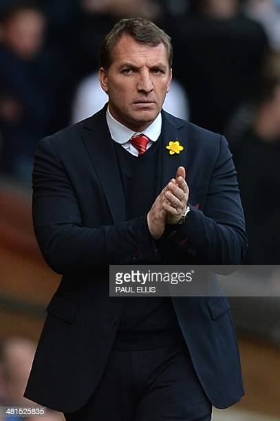 Liverpool's Northern Irish manager Brendan Rodgers watches the action from the touchline during the English Premier League football match between...