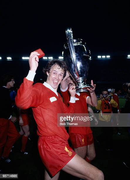Liverpool's Phil Neal celebrates with the trophy at the end of the match between Liverpool and Real Madrid in the European Cup Final held at the Parc...