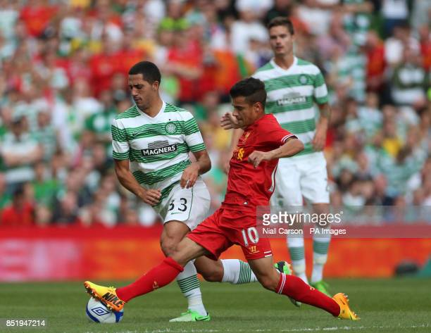 Liverpool's Philippe Coutinho and Celtic's Beram Kayal battle for the ball during the Preseason Friendly at the Aviva Stadium Dublin Ireland