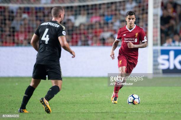 Liverpool's Philippe Coutinho controls the ball during the final of the Premier League Asia Trophy football tournament between Liverpool and...
