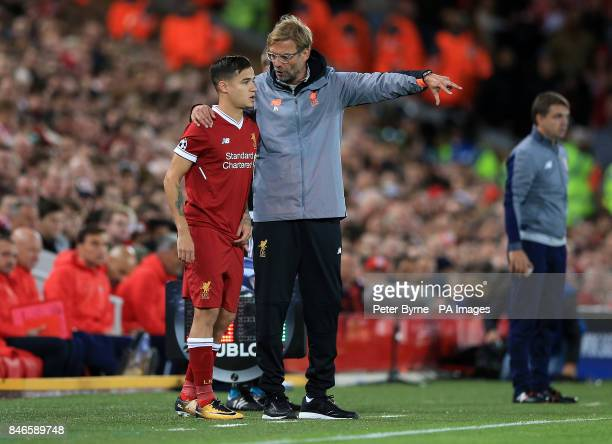 Liverpool's Philippe Coutinho prepares to be subbed on by Liverpool manager Jurgen Klopp during the UEFA Champions League Group E match at Anfield...