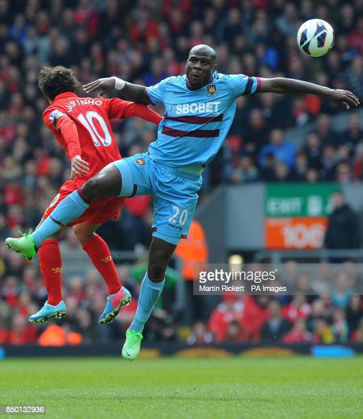 Liverpool's Philippe Coutinho vies with West Ham United's Guy Demel during the Barclays Premier League match at Anfield Liverpool