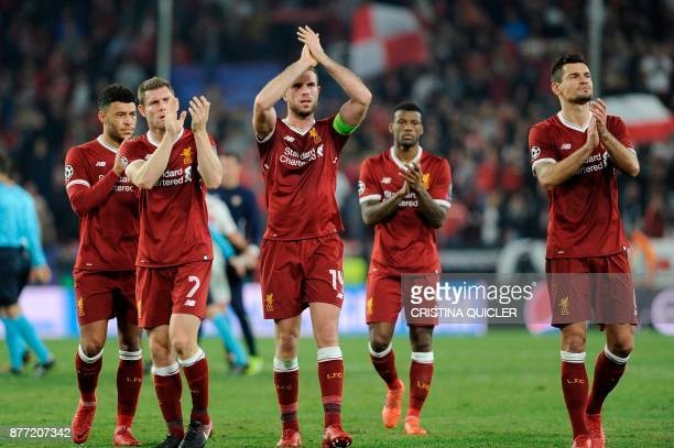 Liverpool's players applaud on November 21 2017 at the Ramon Sanchez Pizjuan stadium in Sevilla during the UEFA Champions League group E football...