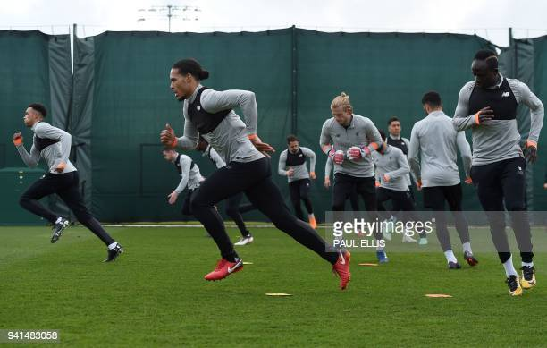 Liverpool's players attend a team training session on the eve of the UEFA Champions League first leg quarterfinal football match between Liverpool...
