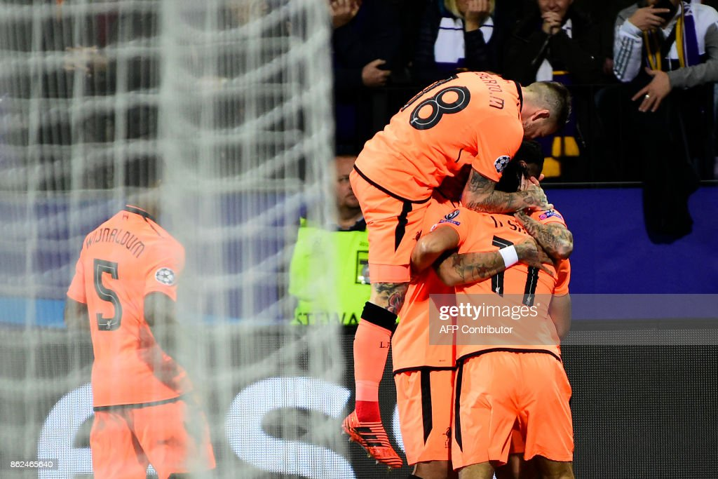 Liverpool's players celebrate after Liverpool's Brazilian forward Roberto Firmino (unseen) scored a goal during the UEFA Champions League group E football match between NK Maribor and Liverpool at the Ljudski vrt Stadium, in Maribor, on October 17, 2017. / AFP PHOTO / Jure Makovec