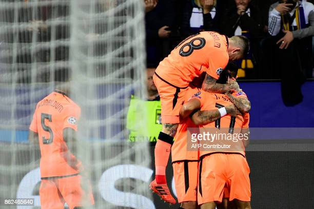 Liverpool's players celebrate after Liverpool's Brazilian forward Roberto Firmino scored a goal during the UEFA Champions League group E football...