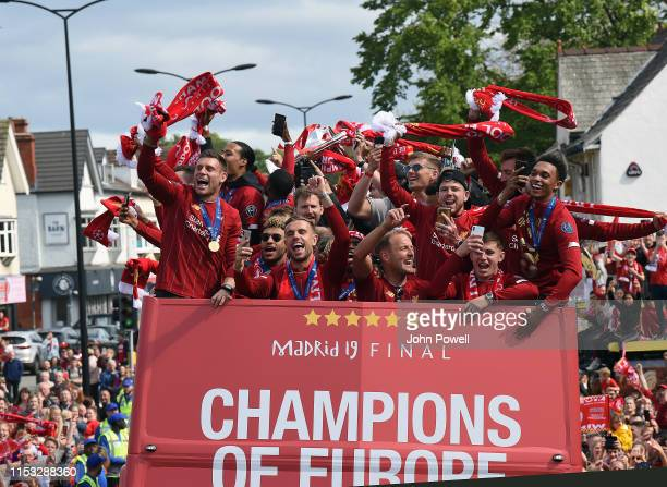 Liverpool's players celebrate on board an opentop bus during the UEFA Champions League victory parade after winning yesterday's final against...