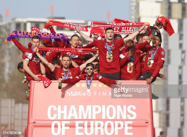 Liverpool's players celebrate on board an opentop parade bus during the UEFA Champions League victory parade after winning yesterday's final against...