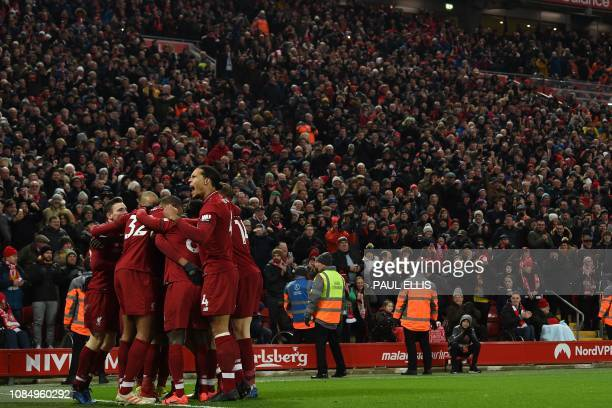 Liverpool's players celebrate Roberto Firmino's first goal during the English Premier League football match between Liverpool and Crystal Palace at...