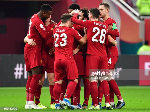 Liverpool's players celebrate their opening goal during the 2019 FIFA Club World Cup semi-final football match between Mexico's Monterrey and...