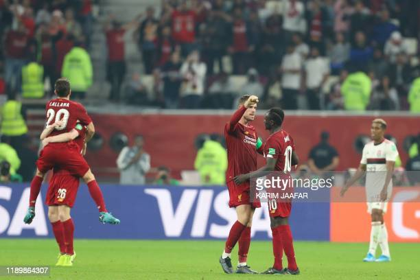Liverpool's players celebrate their win during the 2019 FIFA Club World Cup Final football match between England's Liverpool and Brazil's Flamengo at...