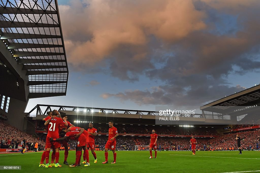 Liverpool's players celebrate together after Firmino scores their fourth goal during the English Premier League football match between Liverpool and Leicester City at Anfield in Liverpool, north west England on September 10, 2016. Liverpool won the game 4-1. / AFP / Paul ELLIS / RESTRICTED TO EDITORIAL USE. No use with unauthorized audio, video, data, fixture lists, club/league logos or 'live' services. Online in-match use limited to 75 images, no video emulation. No use in betting, games or single club/league/player publications. /