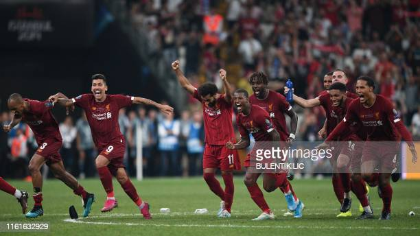 Liverpool's players celebrate winning the UEFA Super Cup 2019 football match between FC Liverpool and FC Chelsea at Besiktas Park Stadium in Istanbul...