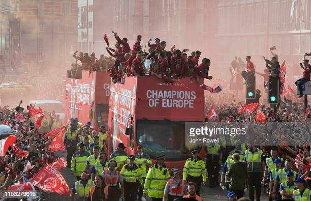 Liverpool's players celebrate with the European Champion Clubs' Cup on board an opentop bus during the UEFA Champions League victory parade after...