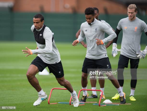 Liverpool's players including their Cameroon defender Joel Matip takes part in a team training session at their Melwood training complex in Liverpool...