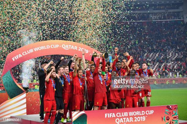 Liverpool's players lift the trophy following the 2019 FIFA Club World Cup Final football match between England's Liverpool and Brazil's Flamengo at...