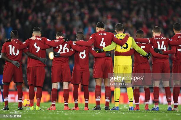 Liverpool's players observe a moment of silence honouring Cardiff's missing Argentinian player Emiliano Sala ahead of the English Premier League...
