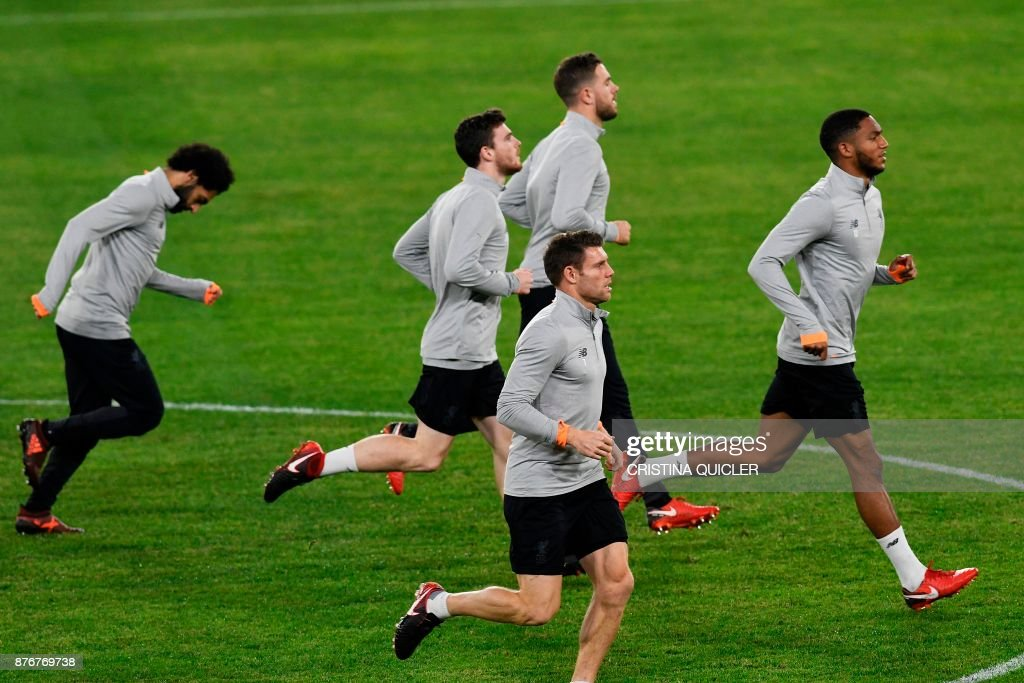 Liverpool's players run during a training session at Ramon Sanchez Pizjuan stadium in Sevilla on November 20, 2017 on the eve of the UEFA Champions League group E football match between Sevilla and Liverpool. /