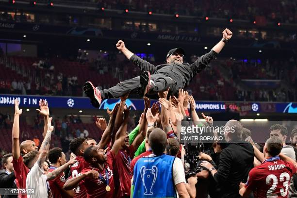 Liverpool's players throw German manager Jurgen Klopp in the air after winning the UEFA Champions League final football match between Liverpool and...