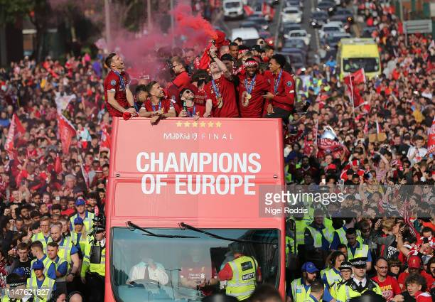 Liverpool's players with the UEFA Champions League trophy on board a parade bus after winning the UEFA Champions League final against Tottenham...