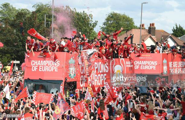 Liverpool's players with the UEFA Champions League trophy on board the opentop bus during the victory parade after winning yesterday's UEFA Champions...