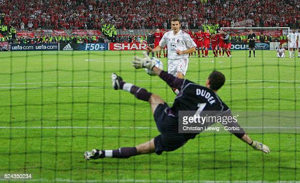 Liverpool's Polish goalkeeper Jerzy Dudek stops a penalty shot from AC Milan's Ukrainian forward Andriy Shevchenko during their Champions League...