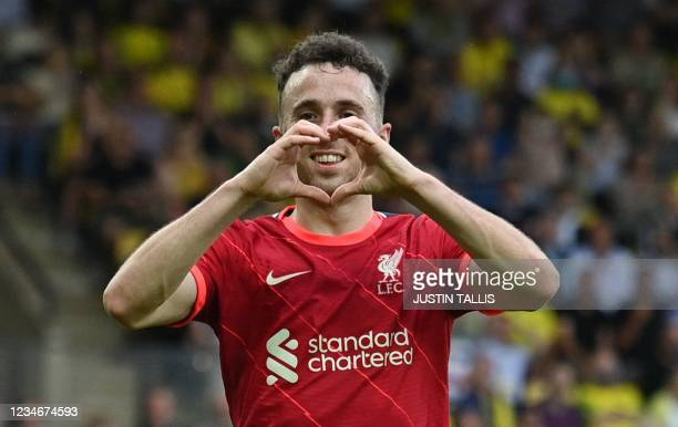Liverpool's Portuguese striker Diogo Jota celebrates scoring the opening goal during the English Premier League football match between Norwich City...