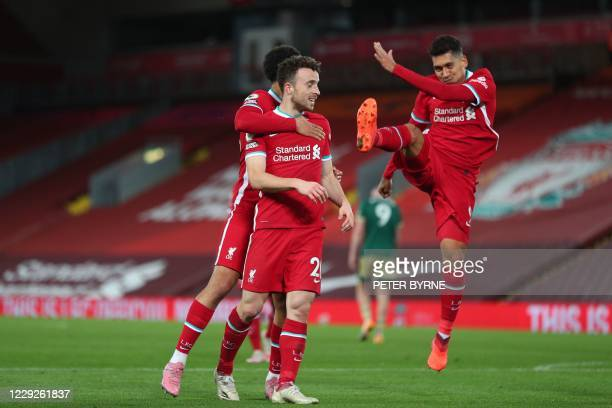 Liverpool's Portuguese striker Diogo Jota celebrates scoring their second goal with Liverpool's English defender Trent Alexander-Arnold and...