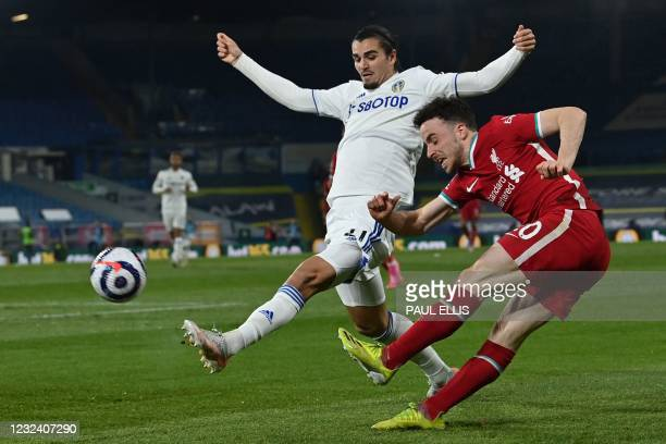 Liverpool's Portuguese striker Diogo Jota crosses the ball during the English Premier League football match between Leeds United and Liverpool at...