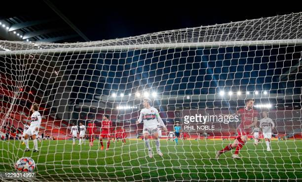 Liverpool's Portuguese striker Diogo Jota puts the ball into an empty net to open the scoring during the UEFA Champions league Group D football match...