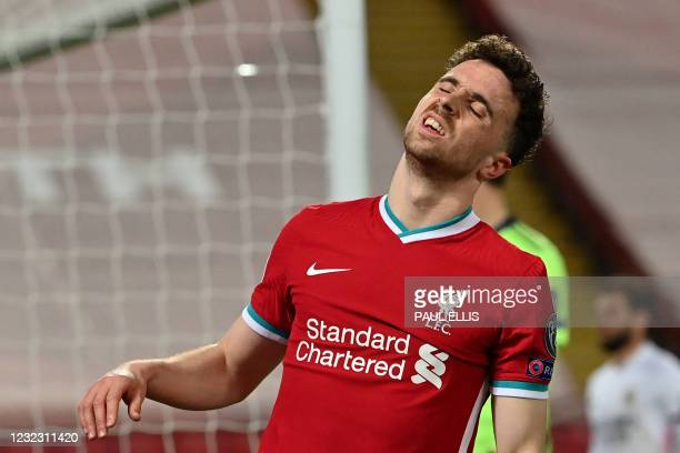 Liverpool's Portuguese striker Diogo Jota reacts to a missed chance during the UEFA Champions League quarter final second leg football match between...