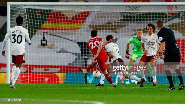 Liverpool's Portuguese striker Diogo Jota scores his team's third goal during the English Premier League football match between Liverpool and Arsenal...