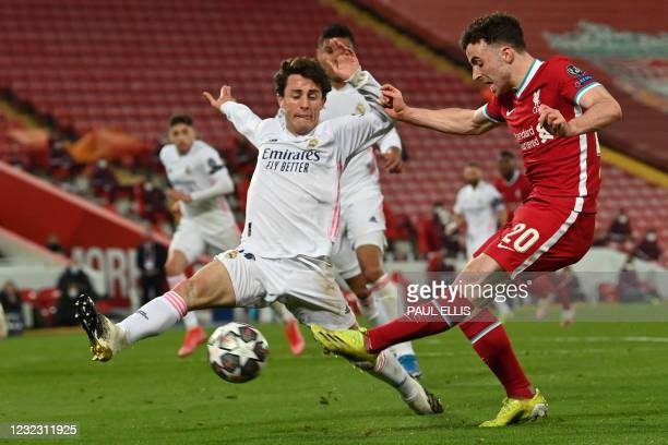 Liverpool's Portuguese striker Diogo Jota shoots wide during the UEFA Champions League quarter final second leg football match between Liverpool and...