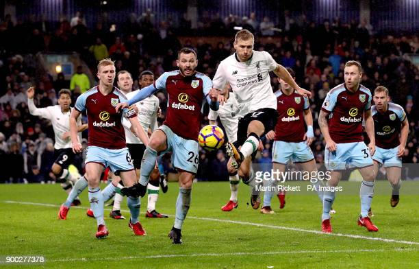 Liverpool's Ragnar Klavan and Burnley's Phil Bardsley battle for the ball during the Premier League match at Turf Moor Burnley