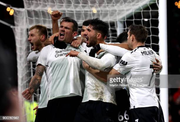 Liverpool's Ragnar Klavan celebrates scoring his side's first goal of the game with teammates including Liverpool's Dejan Lovren during the Premier...