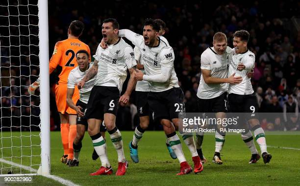 Liverpool's Ragnar Klavan celebrates scoring his side's second goal of the game with teammate Liverpool's Roberto Firmino Dejan Lovren and Emre Can...